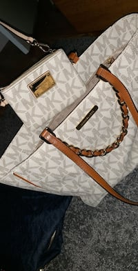 white and brown Michael Kors monogram leather handbag
