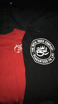 two red and black crew-neck shirts
