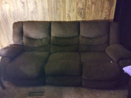 Reclining sofa and love seat with end tables
