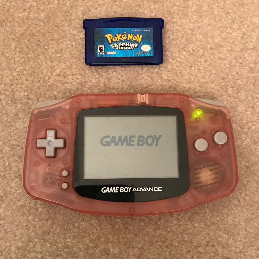 Pink Nintendo GameBoy Advance system with Pokemon Sapphire video game