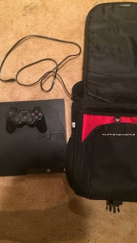 black Sony PS3 console with controller