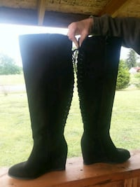pair of black knee-high boots Grand Mound