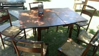 Brown extendable table with 6 chairs Palmdale, 93550