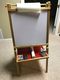 Easel with chalkboard, white board, and paper roll; good condition