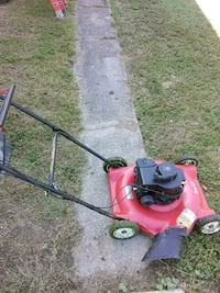 red and black push mower 168 mi