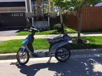Gray motor scooter