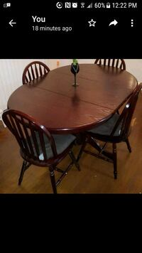 oval brown wooden table with four chairs dining set Toronto, M1X 1V8