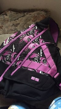 black, pink, and white floral crossbody backpack