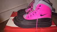 Pair of pink-and-black nike high tops Akron, 44306