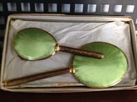 oval yellow framed green handheld mirrors