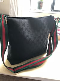 black and red Coach leather shoulder bag Vancouver, V6P 2X3