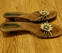 pair of brown slip on shoes size 8.5