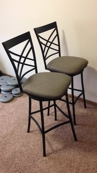 two black metal framed gray padded chairs Fargo