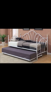 White metal scrolled trundle daybed