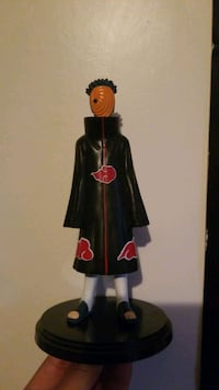 **Holding***Tobi action figure from Naruto