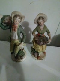 two ceramic figurines of farmers Fountain, 32438