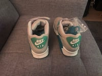 pair of white-and-green Nike sneakers Springfield, 22152