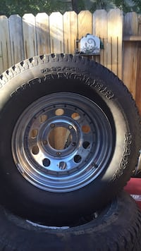 black bullet hole car wheel with tire Carson City, 89703