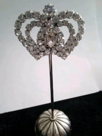 Silver colored stand with glass, crown