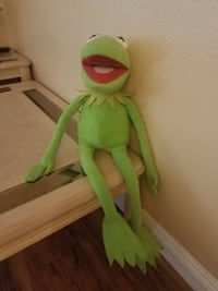green and yellow frog plush toy null