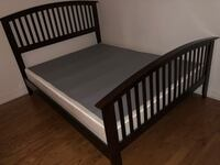 Queen sized - Brown bed frame with white and gray box.
