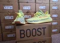 Pair of yellow adidas yeezy boost 350 v2 with box