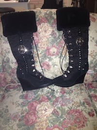 pair of black leather heeled boots Calgary, T2E