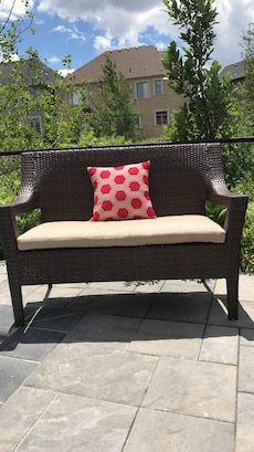 Outdoor patio bench with cushion