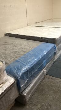 three white and gray bed mattresses