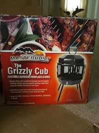BRAND NEW PORTABLE FIREPLACE AND GRILL sealed in box