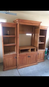 brown wooden TV hutch with flat screen television Scottsdale, 85260