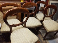 four brown wooden framed white padded chairs Montreal
