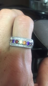 Silver-colored and multi-colored stone encrusted ring!