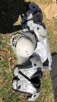 Young football shoulder pads and helmet
