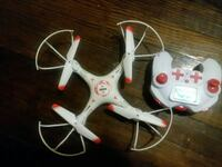 white and red drone with controller