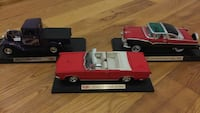 Three assorted color scale model diecast cars