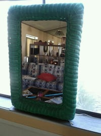 Hanging mirror. Wicker frame, green in color.The Cathedral City, 92234
