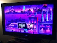 black flat screen TV with text overlay Houston, 77054