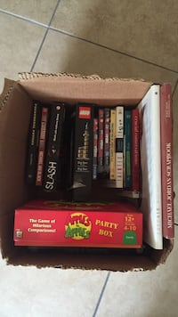 Assorted books, games and Apples to Apples. San Diego, 92104