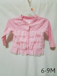 girl's pink button-up shirt