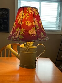Watering can lamp and maroon floral shade