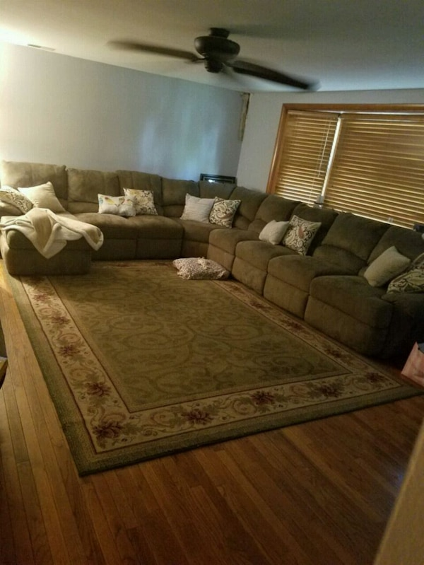 Reclining,Green fabric sectional sofa  and rug