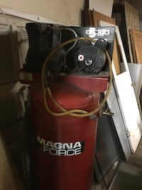 Red and black magna force air compressor