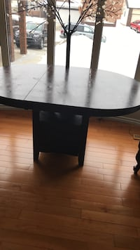 Solid table good condition and good shape asking 300$ it comes with2chairs  Edmonton, T5X 4Z8