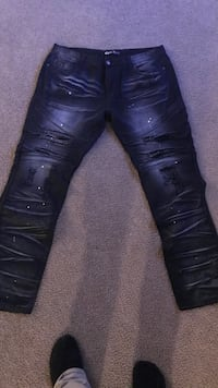 pair of black leather knee-high boots Concord, 28025
