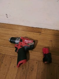 red and black Milwaukee cordless impact wrench Oakland, 94621