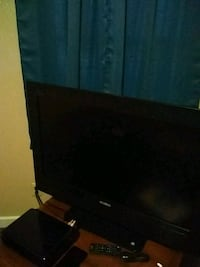black flat screen TV with black wooden TV stand Dallas, 75218