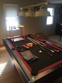Red and black billiard table set