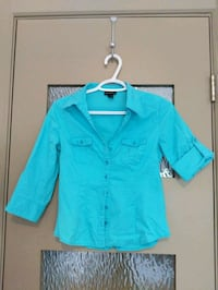 Blue blouse with some spandex size small Calgary, T2E 0B4