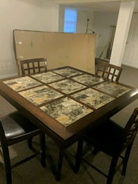 rectangular brown wooden table with four chairs di 401 mi